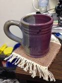 Handmade mug with handwoven coaster.