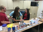 Students build their prototype catapult.